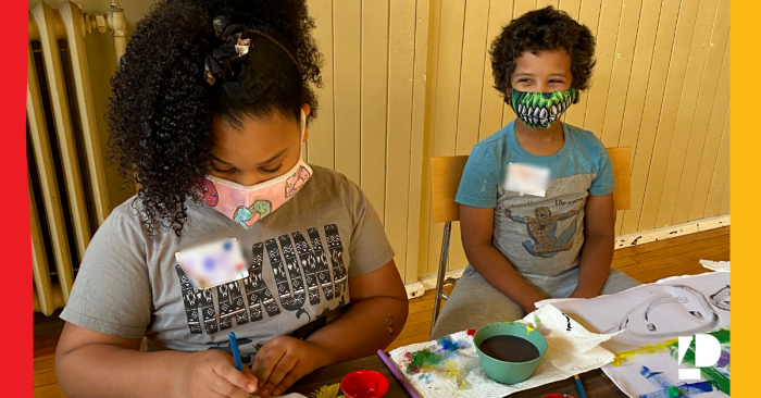 Two children taking part in arts and crafts time at Camp ELSO's Wayfinders Spring Break Camp.